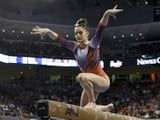As If Beam Wasn't Hard Enough, Watch This Gymnast Land Her Signature Flip to 1 Knee