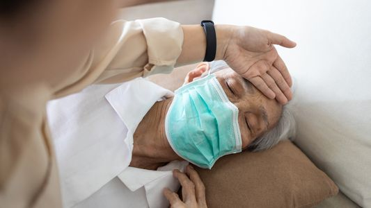 Chinese factory worker caught rubbing dirty feet on face masks intended for export