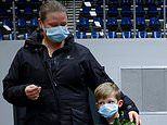 Masks DON'T stop the spread of Covid: Top experts criticise 'troubling lack of evidence'