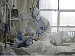 First pictures show Chinese doctors in hazmat suits treating patients with deadly coronavirus